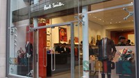 Paul Smith storefront, mannequins wear the latest business attire line